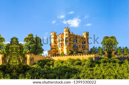 Castle landscape in sunny day. Castle hill landscape. Yellow castle landscape. Castle on blue sky background #1399330022