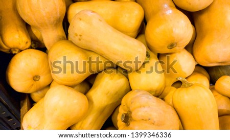 Closeup image of orange pumpking in begetable soter.Closeup texture or pattern of fresh ripe vegetables. Beautiful food background #1399346336