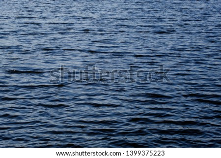 Light playing on the sea surface. Water surface. Sea surface. Water background. Blue water surface.  #1399375223