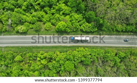 Wagon driving on the highway, aerial. Transport logistics background top view.  #1399377794