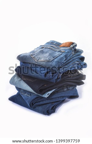 Close up stacked of different Jeans background.  #1399397759