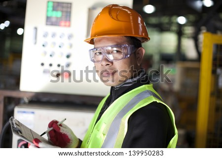 Portrait of asian engineer taking notes in the factory #139950283