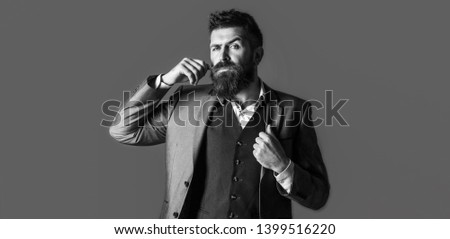 Male beard and mustache. Handsome stylish bearded man. Bearded man in suit and bow-tie. Sexy male, macho, long beard. Studio portrait of a bearded hipster man. Black and white #1399516220