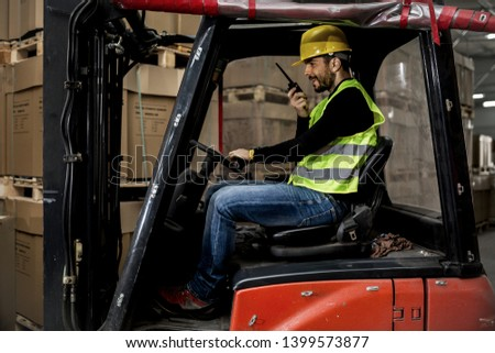 Warehouse Workers on duty,factory  and forklift #1399573877