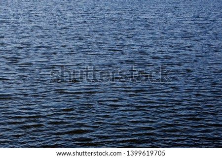 Light playing on the sea surface. Water surface. Sea surface. Water background. Blue water surface. Abstract blue water  #1399619705