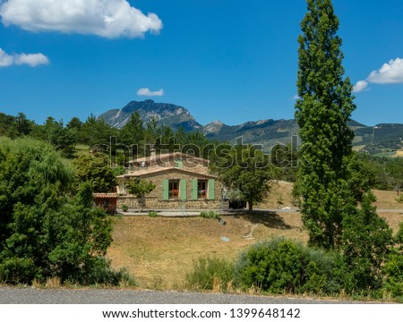 Tourism and recreation in Europe. Beautiful view with vintage authentic france villa in summer. #1399648142