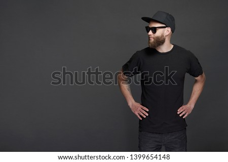 Hipster handsome male model with beard wearing black blank baseball cap with space for your logo #1399654148