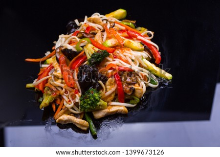 Asian menu restaurant food. Udon noodles with vegetables and mushrooms on black background. #1399673126