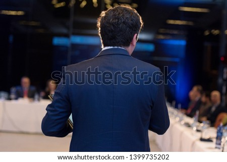 Young businessman at business conference room with public giving presentations. Audience at the conference hall. Entrepreneurship club. #1399735202