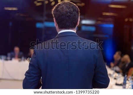 Young businessman at business conference room with public giving presentations. Audience at the conference hall. Entrepreneurship club. #1399735220