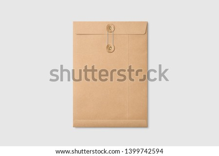 Real photo, kraft paper A4/C4 size string and washer envelope mockup template, isolated on light grey background. High resolution. Royalty-Free Stock Photo #1399742594