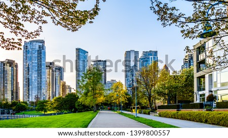Skyscapers lining the skyline of Yaletown and David Lam Park along False Creek Inlet of Vancouver, British Columbia, Canada #1399800557