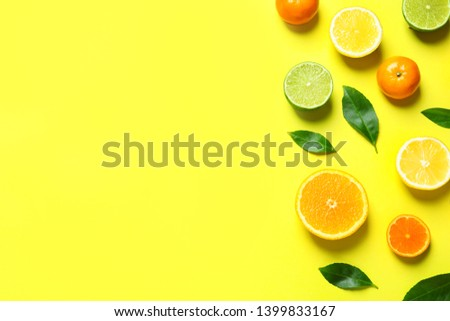 Different citrus fruits and leaves on color background, flat lay. Space for text #1399833167