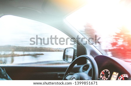 View through the moving car windscreen inside the car interior. #1399851671