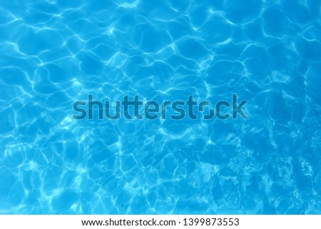 Blue color water in swimming pool rippled water detail background. #1399873553