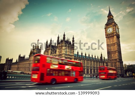 London, the UK. Red bus in motion and Big Ben, the Palace of Westminster. The icons of England in vintage, retro style Royalty-Free Stock Photo #139999093
