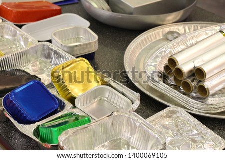 Many different products from aluminum. Aluminum food packaging, Foil. Disposable food containers made of aluminum. #1400069105