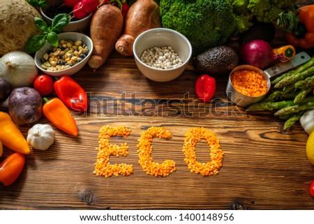 Assortment of fresh vegetables on wooden background #1400148956