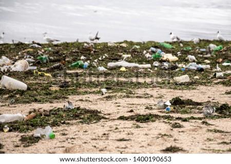 Rubbish on the beach. Sea, seagulls, seaweed, sand, garbage, plastic. #1400190653