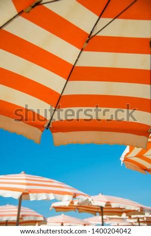 Underneath a Striped Parasol on the Beach in Viarregio Royalty-Free Stock Photo #1400204042
