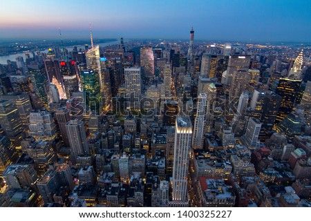 New york skyline during sunset from empire state building #1400325227