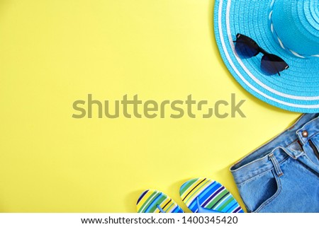 Women's accessories summer travel on yellow background with blank space for text. Copy space, Flat lay #1400345420