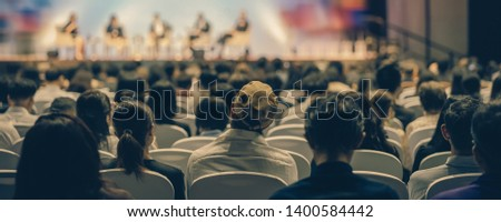 Banner cover page of Rear view of Audience listening Speakers on the stage in the conference hall or seminar meeting, business and education about investment concept #1400584442