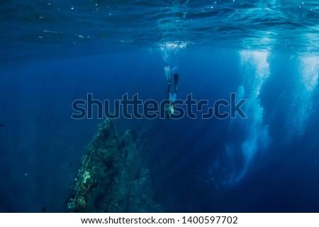 Freediver man dive underwater at shipwreck in Bali. Freediving in ocean #1400597702