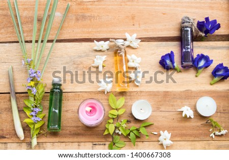 natural herbal oils extract vegetation lemongrass , flowers jasmine and blue flower butterfly pea smells scents aroma arrangement flat lay style on background wooden #1400667308