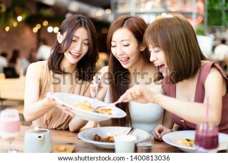Group of Happy friends having dinner in the restaurant #1400813036