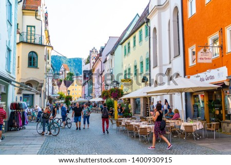 FUSSEN, GERMANY - AUG 28, 2018: Street cafe in the Fussen old town city centre. Fussen is a small town in Bavaria, Germany. #1400930915