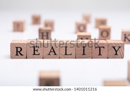 Close-up Of Wooden Blocks With Reality Word Over White Desk #1401011216
