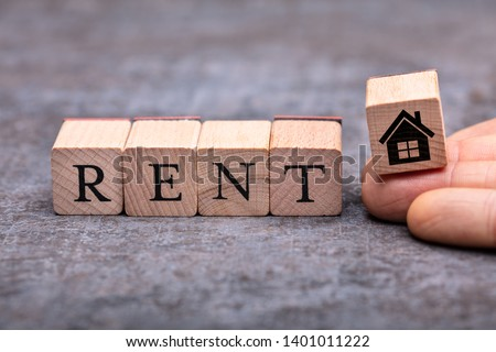 Close-up Of Person's Hand Placing House Icon Wooden Block Beside Rent Word Blocks #1401011222