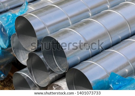 Pipes for ventilation system have been stacked and are located here on the construction site. #1401073733