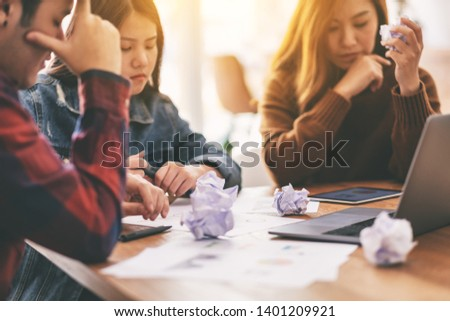 Three businessman get stressed while having a problem in business meeting #1401209921