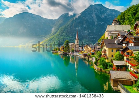 Picturesque alpine village touristic location. The best well known famous old alpine village with spectacular misty lake and wooden houses, Hallstatt, Salzkammergut region, Austria, Europe #1401358433