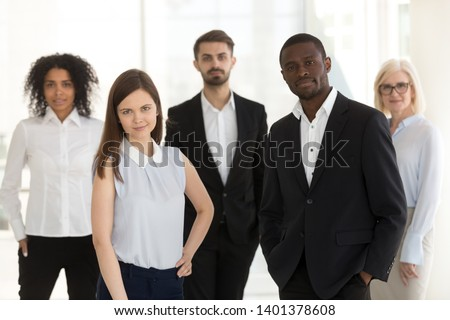 Portrait of diverse confident work team looking at camera, successful multiethnic managers posing for photo in office together, employees motivated for success or business achievement #1401378608