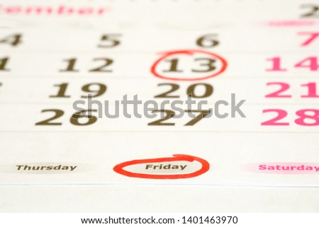 Friday the 13th. Red marked on a calendar concept for an important day.  #1401463970
