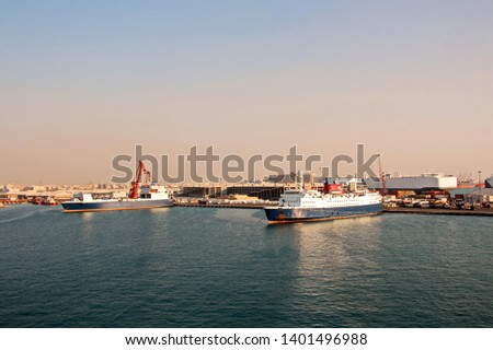 Various types of vessels calling at the port and moored at the berth. Tugs in the port. Jeddah Port, Saudi Arabia. December, 2018 #1401496988
