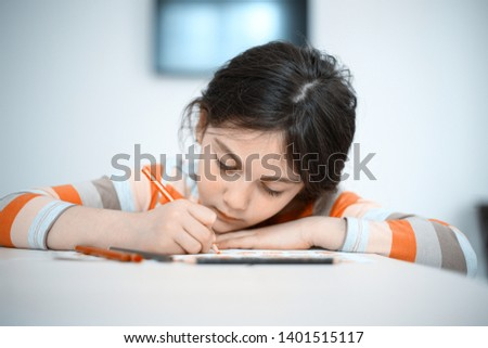 girl child studying at home lesson #1401515117