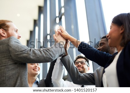 Several young successful employees or politicians keeping their hands together while expressing teambuilding and partnership #1401520157