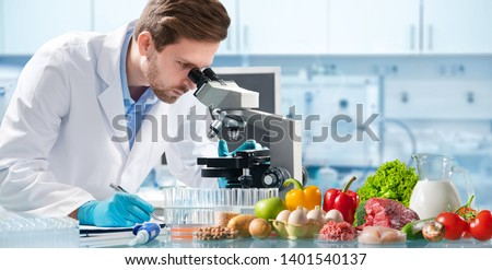 Food quality control expert inspecting specimens of groceries in the laboratory Royalty-Free Stock Photo #1401540137