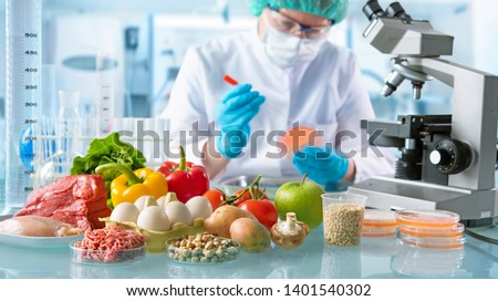 Food quality control expert inspecting specimens of groceries in the laboratory Royalty-Free Stock Photo #1401540302