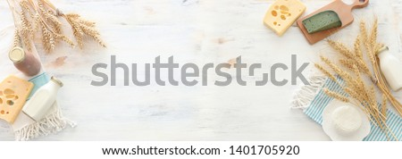 top view photo of dairy products over white wooden background. Symbols of jewish holiday - Shavuot #1401705920