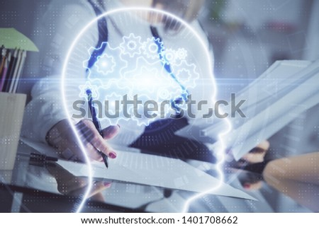 Multi exposure of woman's writing hand on background with brain hud. Concept of learning. #1401708662