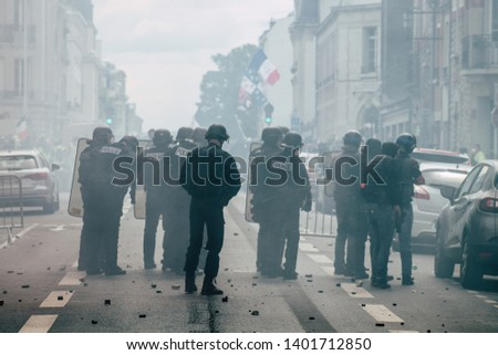 Reims France May 18, 2019 View of the rioters and policemen fighting face to face in the streets of Reims during protests of the Yellow Jackets in the streets of Reims on saturday afternoon #1401712850