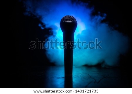Microphone for sound, music, karaoke in audio studio or stage. Mic technology. Voice, concert entertainment background. Speech broadcast equipment. Live pop, rock musical performance #1401721733