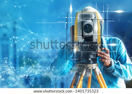 engineer site survey with laser tripod machine in site construction background #1401735323