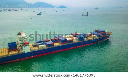 Aerial bird eye view drone photography Cargo ship departing from Hong Kong's industrial port.Logistics and transportation of Container Cargo ship logistic import export in HONG KONG  #1401776093