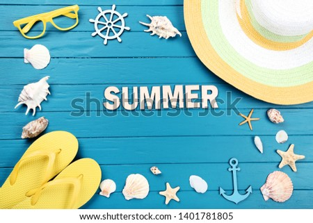 Word Summer with seashells and clothing on blue wooden table #1401781805